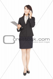 smiling asian  businesswoman with phone isolated on white
