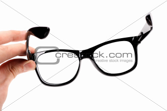 hand with black glasses isolated on white