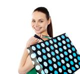 Close-up of happy shopping girl holding bags