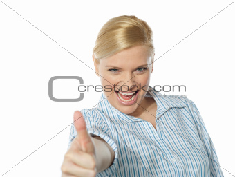 Successful businesswoman showing thumbs-up