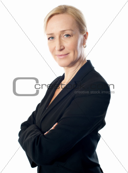 Closeup shot of a senior businesswoman posing with folded arms
