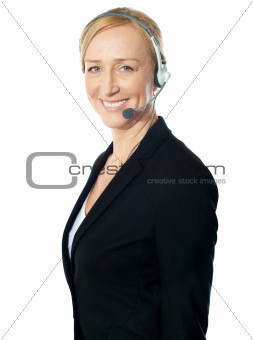 Aged female call centre excutive posing with headsets