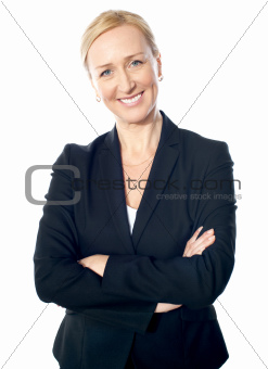 Senior manager poisng with crossed-arms