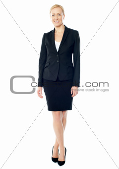 Gorgeous female executive posing with crossed legs