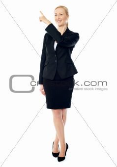 Business lady pointing upwards, copyspace concept