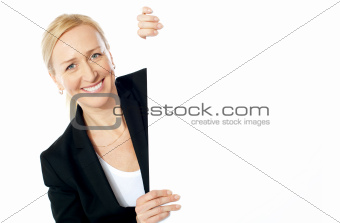 Smiling aged female executive holding clipboard