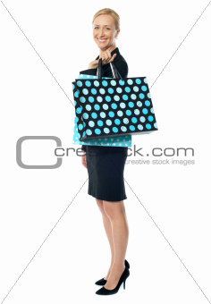 Beautiful woman standing with shopping bag