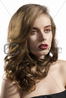 portrait of girl with wavy hair looks at left