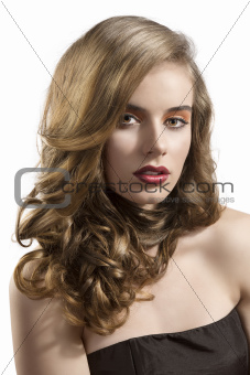 portrait of girl with wavy hair and sensual expression