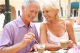 Senior Couple Enjoying Coffee And Cake In CafŽ