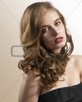 portrait of girl with wavy hair and folded head