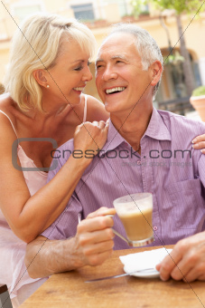 Senior Couple Enjoying Coffee And Cake In CafŽ