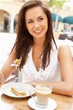 Young Woman Enjoying Coffee And Cake In CafŽ