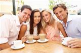 Group Of FriendsEnjoying Coffee In CafŽ