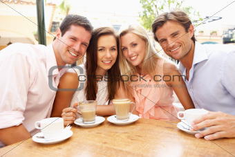Group Of FriendsEnjoying Coffee In CafŽ