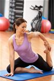 Woman Doing Stretching Exercises In Gym