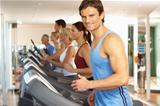 Man On Running Machine In Gym