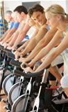 Man Cycling In Spinning Class In Gym
