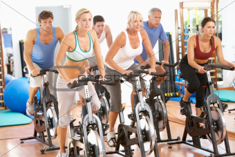 Group Of People In Spinning Class In Gym