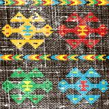 Old canvas or carpet with ethnic motifs