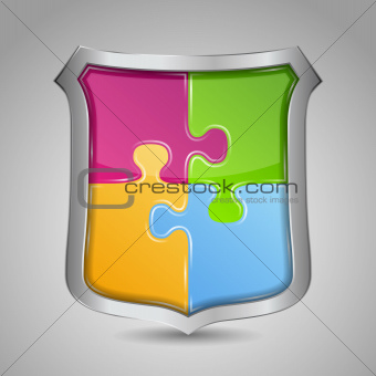 Shield with puzzle pieces