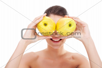 woman holding apples over her eyes
