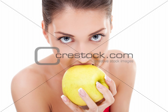 woman about to bite into an apple