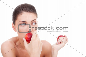 woman eating peaches