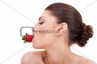 sexy woman with strawberry in mouth
