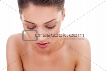 woman looking down, pensive