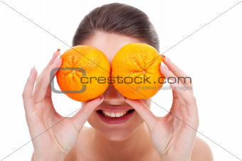 woman with oranges in her hands