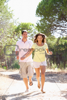 Young couple, holding hands, walking,walk in park