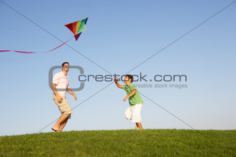 Young parent, father with child, playing in a field