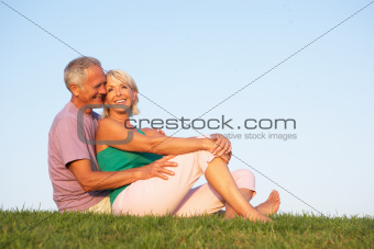 Senior couple posing on a field