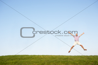 Senior man jumping in air