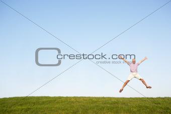 Senior man jumping in air