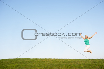 Senior woman  jumping in air
