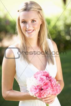 Bride Wearing Dress Holding Bouqet At Wedding