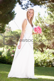 Bride Wearing Dress Holding Bouqet At Wedding