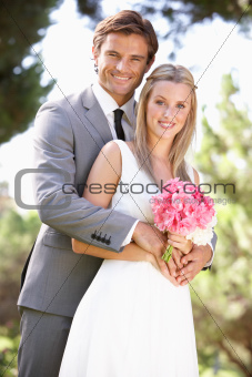 Portrait Of Bridal Couple Outdoors