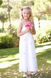 Portrait Of Bridesmaid Holding Bouquet Outdoors