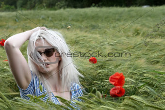 Attractive lady in a poppy field