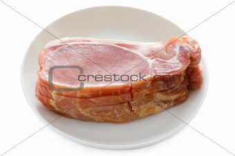 raw back bacon slices isolated on white