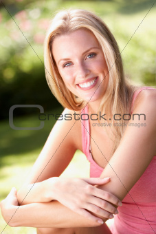 Portrait Of Young Woman Relaxing In Park