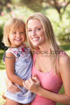 Portrait Of Mother And Child Relaxing In Park