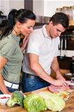 Couple preparing lunch in kitchen