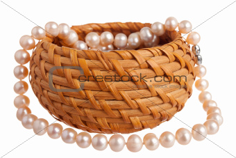 Pink pearl nacklace in a basket