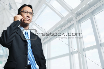 Modern Asian Male Businessman on phone
