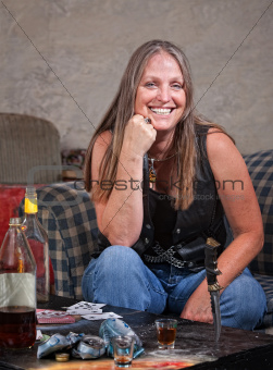 Smiling Woman with Knife Stuck in Table