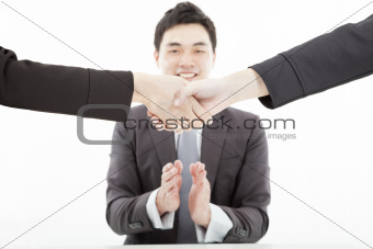 handshaking against businessman applauding hands